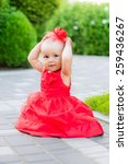 cute baby in a red park nature... | Shutterstock . vector #259436267