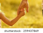 hand of parent and child | Shutterstock . vector #259437869