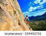 female rock climber climbs on a ... | Shutterstock . vector #259452731
