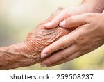 senior and young holding hands | Shutterstock . vector #259508237