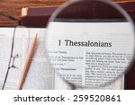 """Small photo of CHIANGMAI, THAILAND, March 4,2015. Reading The New International Version of the Holy Bible on the page of """" 1 thessalonians """" at home. March 4,2015"""