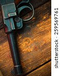 Small photo of part of an old Luger pistol. Parabellum close up. Instagram image retro style