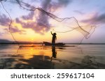 Fisherman of Bangpra Lake in action when fishing, Thailand - stock photo