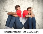 Young Couple Holding Broken...