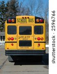 School bus in the neighborhood showing the back - stock photo