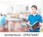 boy with a book in a school  | Shutterstock . vector #259676687