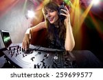 caucasian female dj using a... | Shutterstock . vector #259699577