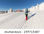 Cross Country Skier Climbing A...