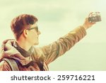 hiker smiling young man takes... | Shutterstock . vector #259716221
