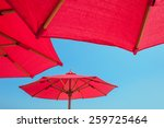 Red Beach Umbrella Against...
