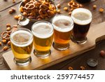 Stock photo assorted beers in a flight ready for tasting 259774457