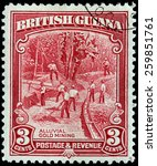Small photo of BRITISH GUIANA - CIRCA 1934: A stamp printed by BRITISH GUIANA shows view of Alluvial Gold Mining, circa 1934