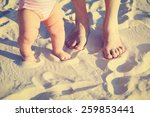 Mother And Baby Feet On Summer...