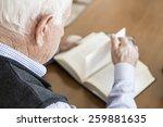 senior man reading book relaxed ... | Shutterstock . vector #259881635