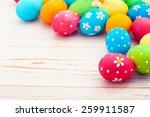 easter eggs on wooden... | Shutterstock . vector #259911587