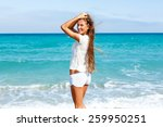 beautiful girl on the beach  | Shutterstock . vector #259950251
