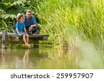 a father and his young son have ... | Shutterstock . vector #259957907