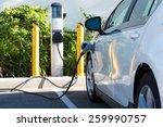 an electric car charging in... | Shutterstock . vector #259990757
