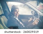 smiling young woman driving a... | Shutterstock . vector #260029319