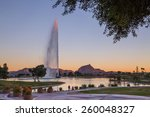 Last ray of the sun hitting the top of the beautiful fountain in Fountain Hills, Arizona with Fire Rock and Four Peaks in the background