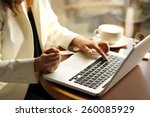 woman shopping online in the... | Shutterstock . vector #260085929