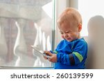 cute baby looking at mobile... | Shutterstock . vector #260139599