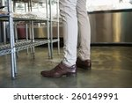 legs of worker standing at the...   Shutterstock . vector #260149991