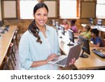 pretty teacher using laptop in... | Shutterstock . vector #260153099