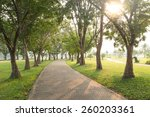 Trees And Walkway On Green...