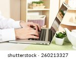 man working on laptop on wooden ... | Shutterstock . vector #260213327