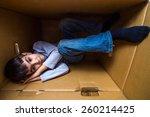 boy fell a sleep in a box | Shutterstock . vector #260214425