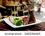 roasted meat on the white plate.... | Shutterstock . vector #260246465