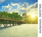 wooden bridge over the. sunrise