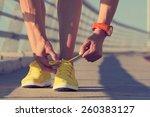 Urban Jogger Tying His Running...