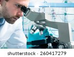 scientist looking through a... | Shutterstock . vector #260417279