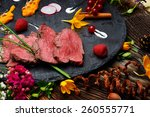 slices of duck fried meat in... | Shutterstock . vector #260555771