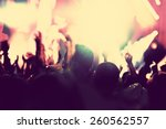 Stock photo concert disco party people with hands up having fun in night club lights vintage mood 260562557