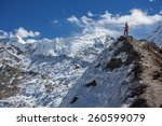hiker on the trek in himalayas  ... | Shutterstock . vector #260599079