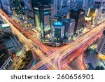 night traffic zips through an... | Shutterstock . vector #260656901