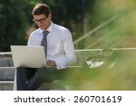 man with laptop at summer park... | Shutterstock . vector #260701619