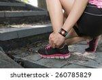 sport woman hand tying... | Shutterstock . vector #260785829