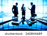 business people talking at the... | Shutterstock . vector #260844689