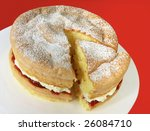 Home-baked sponge cake filled with fresh whipped cream and strawberry jam, and topped with powdered sugar. - stock photo