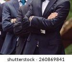 groom and groomsmen behind him... | Shutterstock . vector #260869841