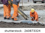 worker leveling concrete poured ... | Shutterstock . vector #260873324