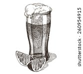 glass of beer on a white...   Shutterstock . vector #260954915