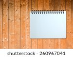 white page of notebook on wood... | Shutterstock . vector #260967041