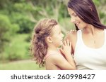 happy mother and daughter... | Shutterstock . vector #260998427