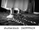 penitent with his feet shackled ... | Shutterstock . vector #260999624