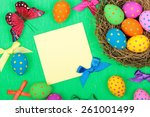 easter greeting card with eggs  ... | Shutterstock . vector #261001499